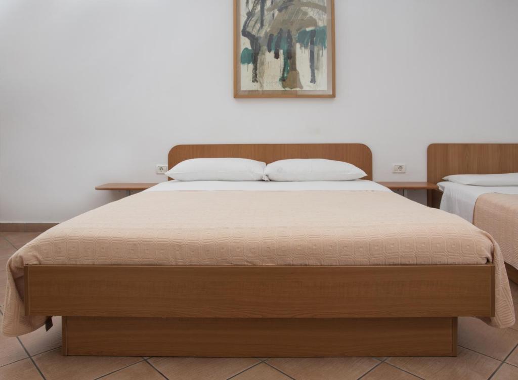 Ein Bett oder Betten in einem Zimmer der Unterkunft Jazz Apartments