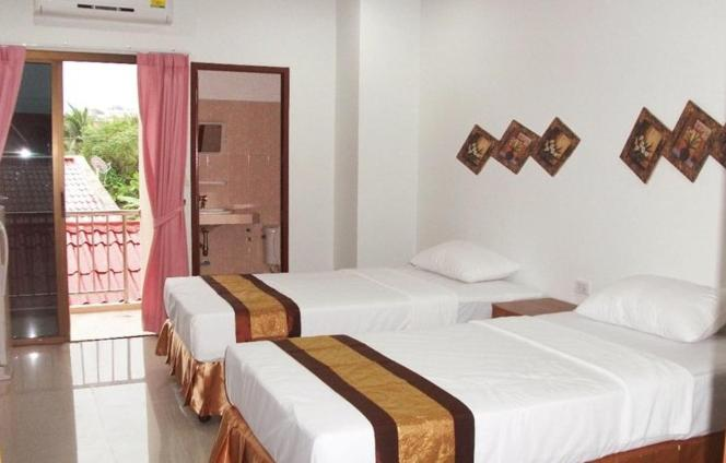 A bed or beds in a room at G&B Guesthouse
