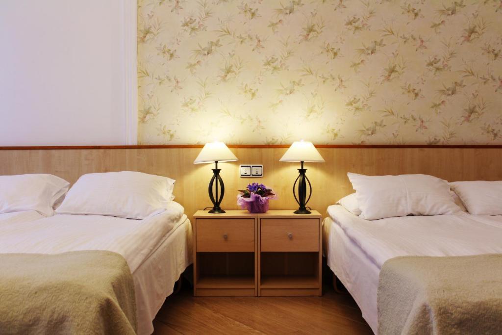 Lova arba lovos apgyvendinimo įstaigoje Hotel NB