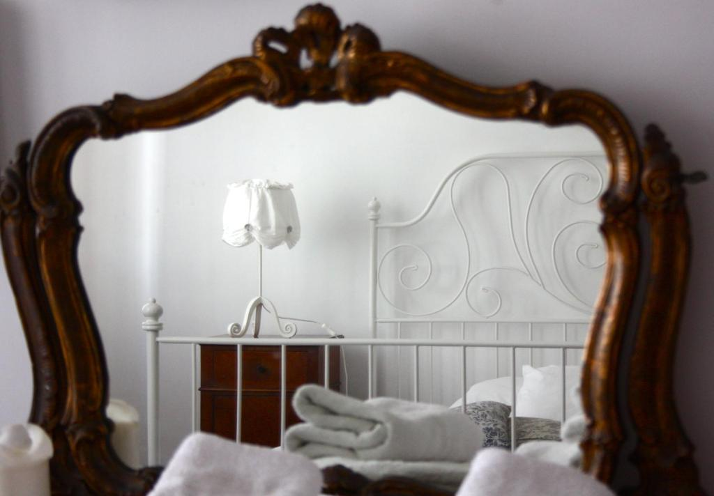 A bed or beds in a room at Dimora Novecento