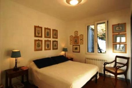 A bed or beds in a room at La Casa Del Pescatore B&B