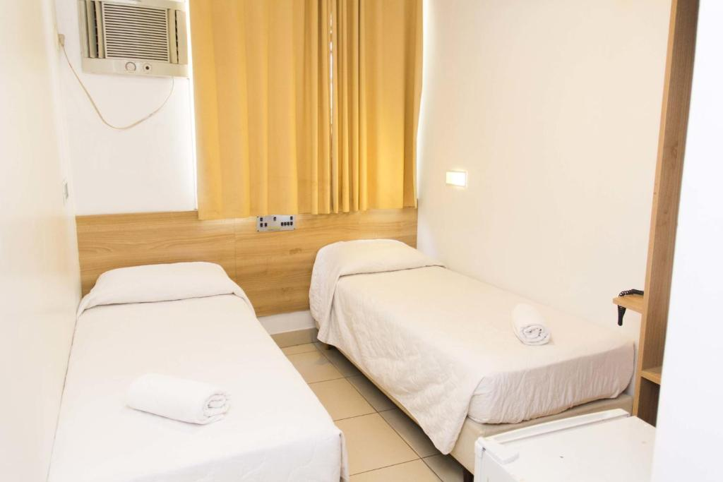A bed or beds in a room at Minuano Hotel Home