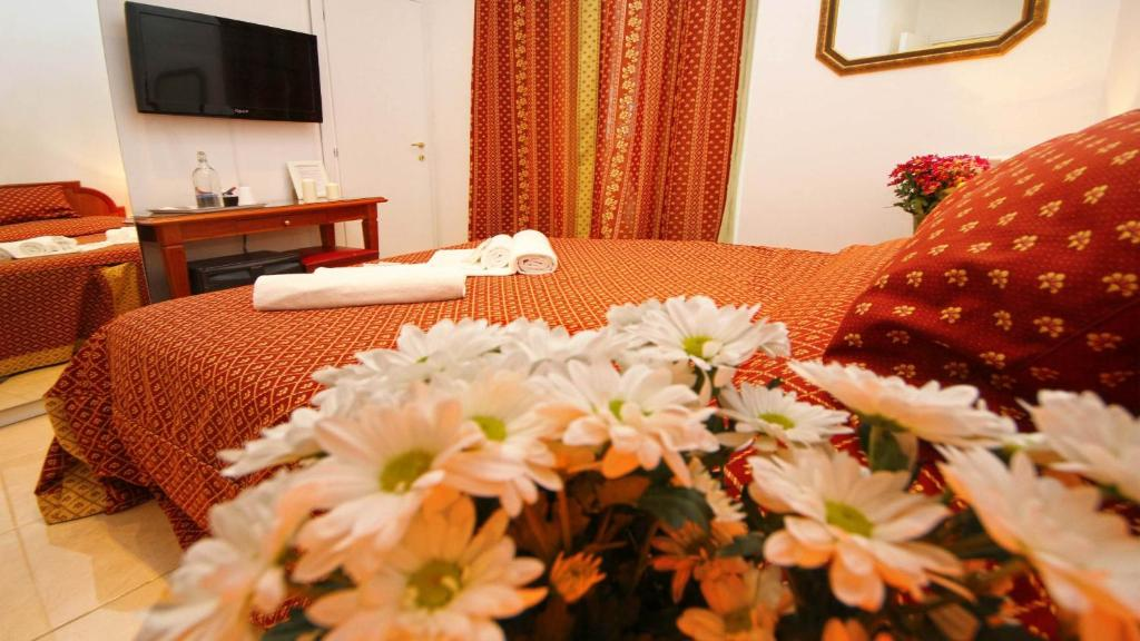 A bed or beds in a room at King Rome Center