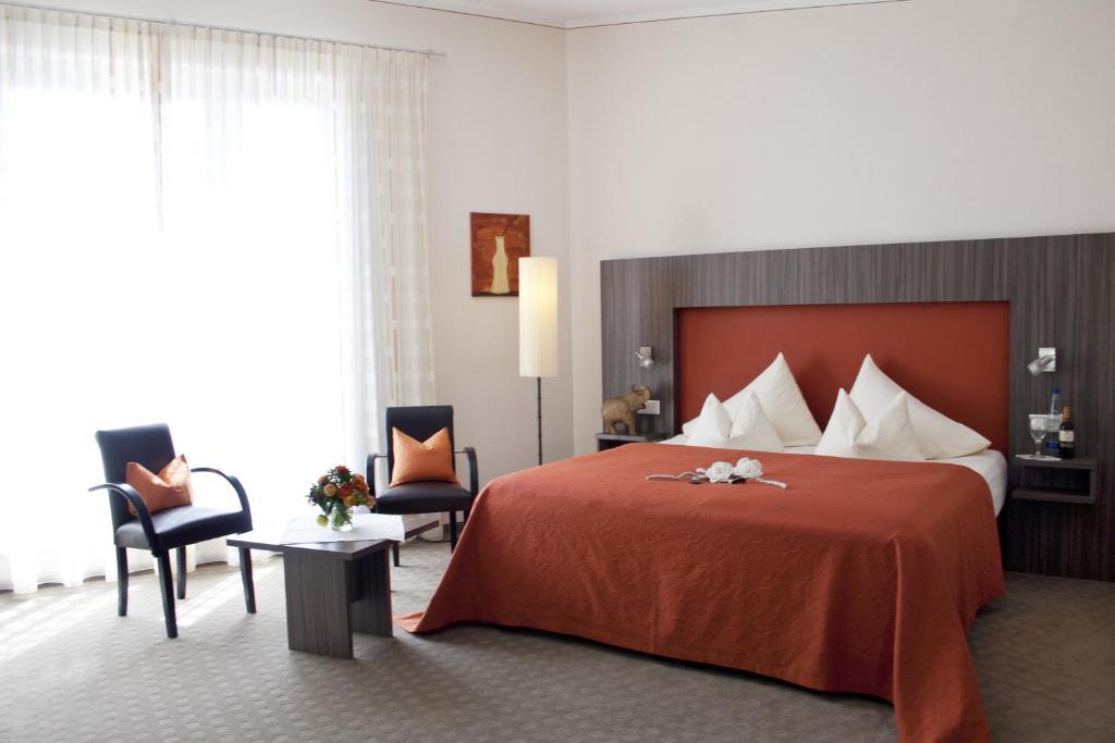 Ein Bett oder Betten in einem Zimmer der Unterkunft Hotel Linner