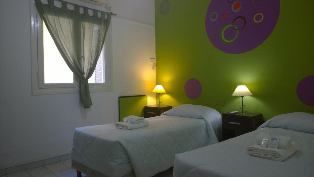 A bed or beds in a room at Koten Hotel