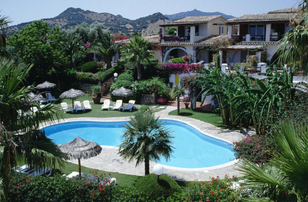 A view of the pool at Residence Le Bouganville or nearby
