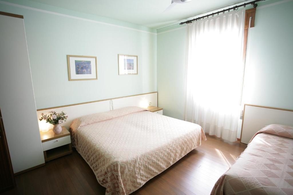 Letto o letti in una camera di Hotel Ezzelino