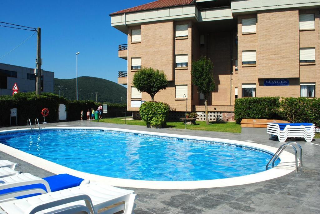 Apartamentos suaces noja precios actualizados 2019 for Apartamentos vacacionales con piscina