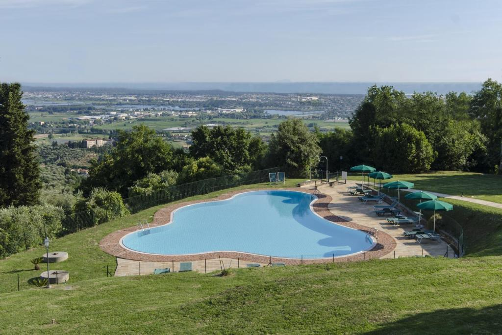 A view of the pool at Frantoio di Corsanico or nearby
