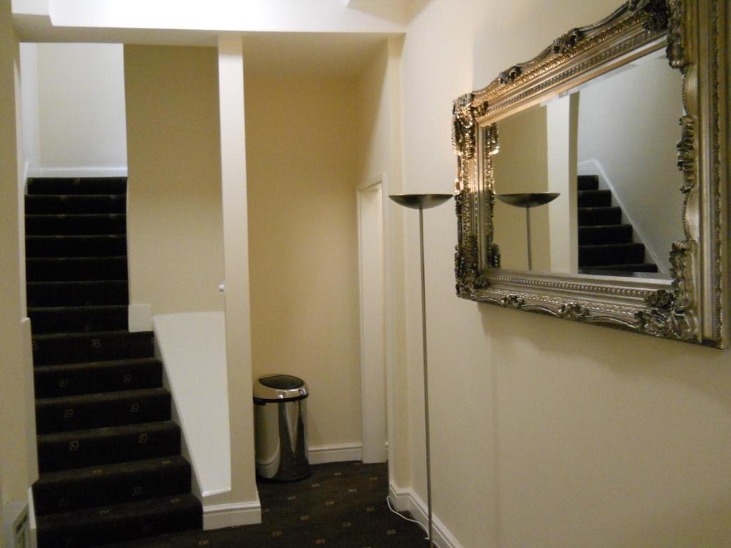 Vannas istaba naktsmītnē Citystay Guest House