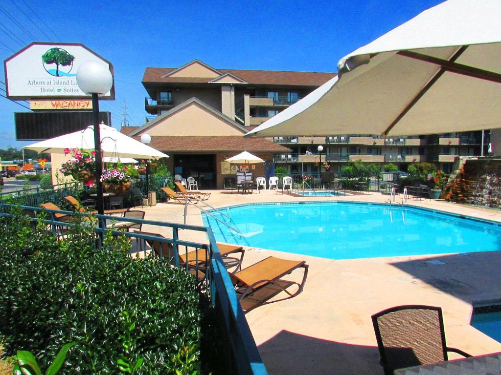 The swimming pool at or near Arbors at Island Landing Hotel & Suites