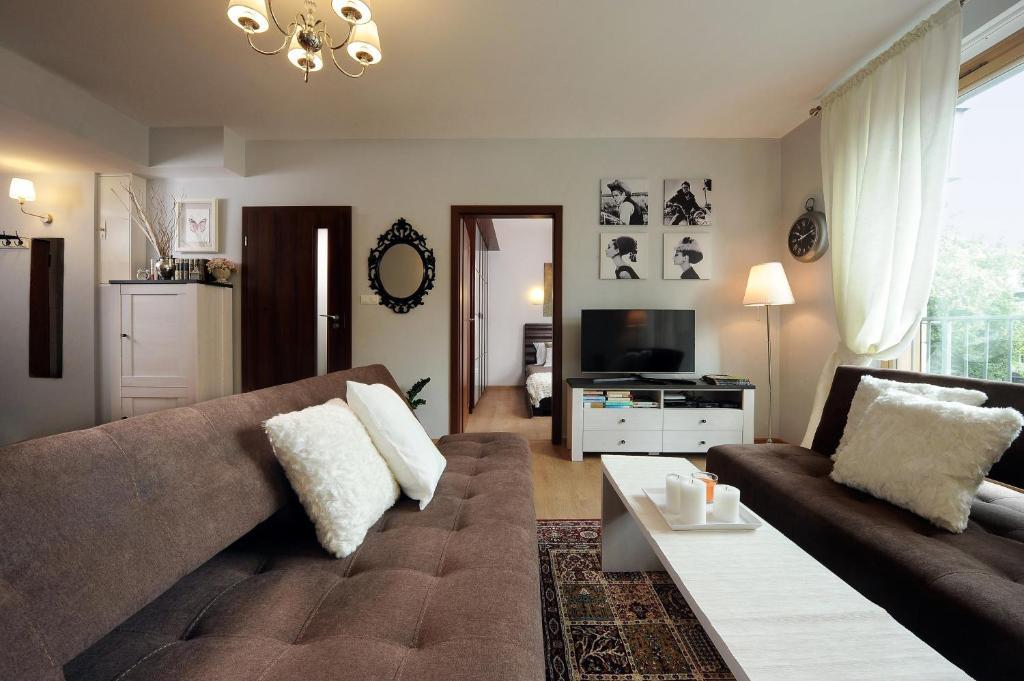 A seating area at Apartament Klasyka