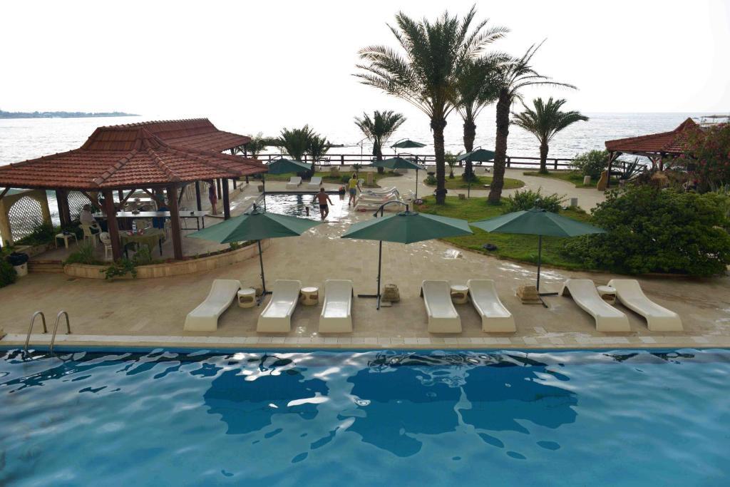 The swimming pool at or near Arcada Marina Hotel