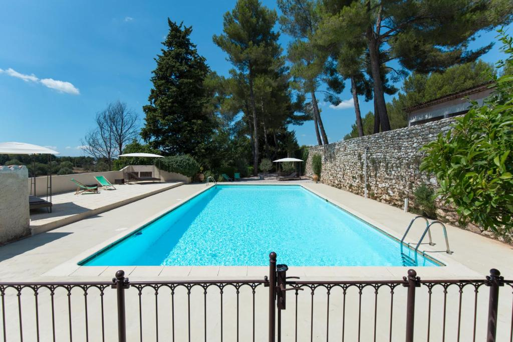 The swimming pool at or near Domaine & Cie