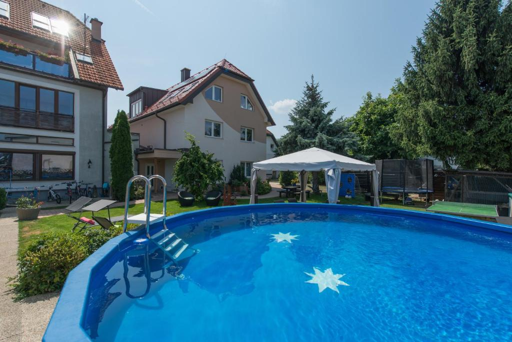 The swimming pool at or near Pension Haus Sanz