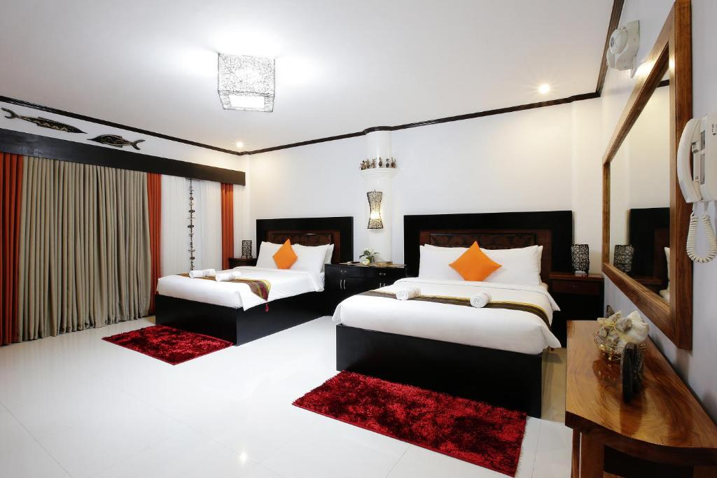 A bed or beds in a room at Coron Bancuang Mansion