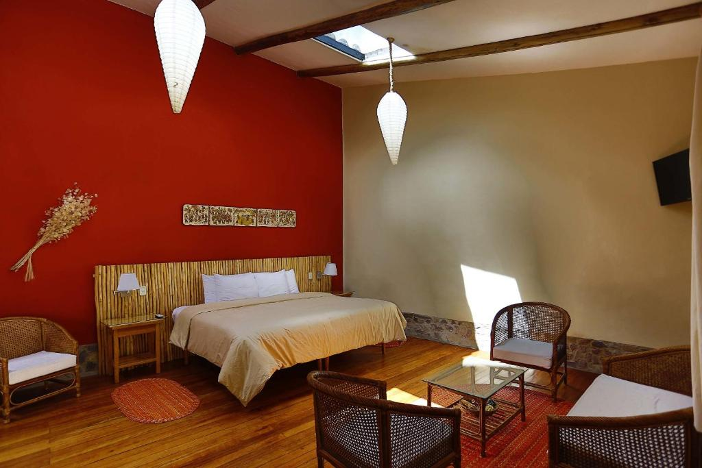 A bed or beds in a room at Hotel Villa Urubamba