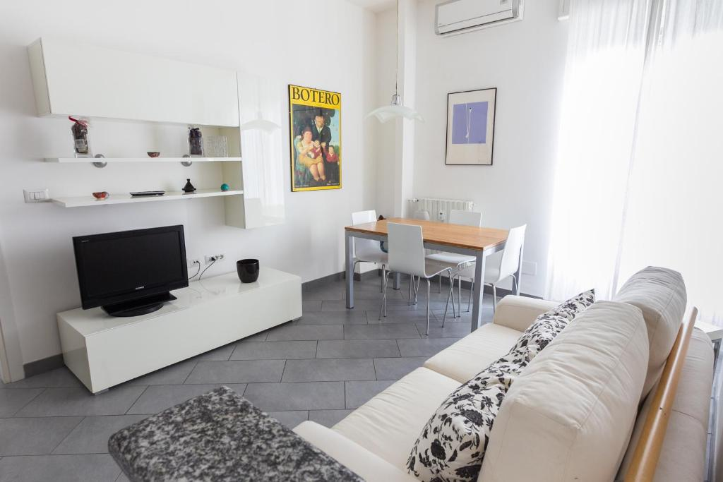 A television and/or entertainment center at Navigli Apartment