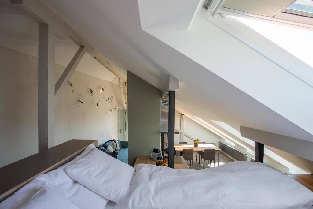 Un ou plusieurs lits dans un hébergement de l'établissement Apartment Murtensee und Alpen