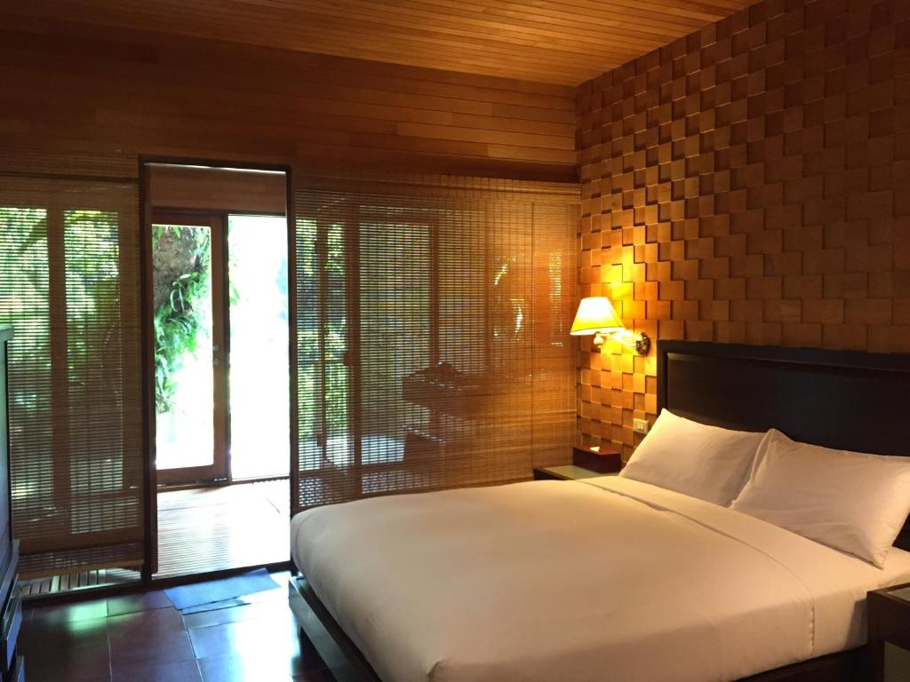 A bed or beds in a room at Silk Valley SPA Resort