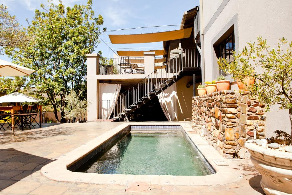 The swimming pool at or near Olive Grove Guesthouse