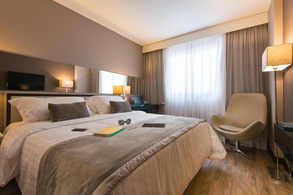 Vuode tai vuoteita majoituspaikassa Hotel Atlantico Prime