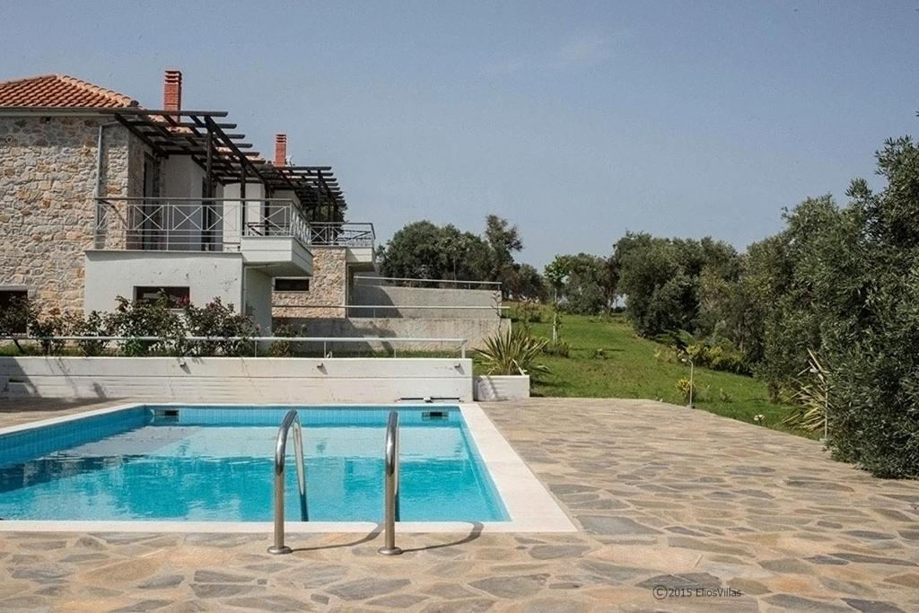 The swimming pool at or near Elios Villas