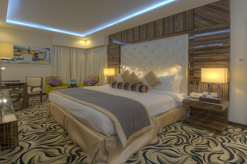 A bed or beds in a room at Orchid Vue Hotel