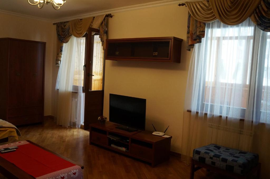 A television and/or entertainment center at New Apartment on Poznyaki