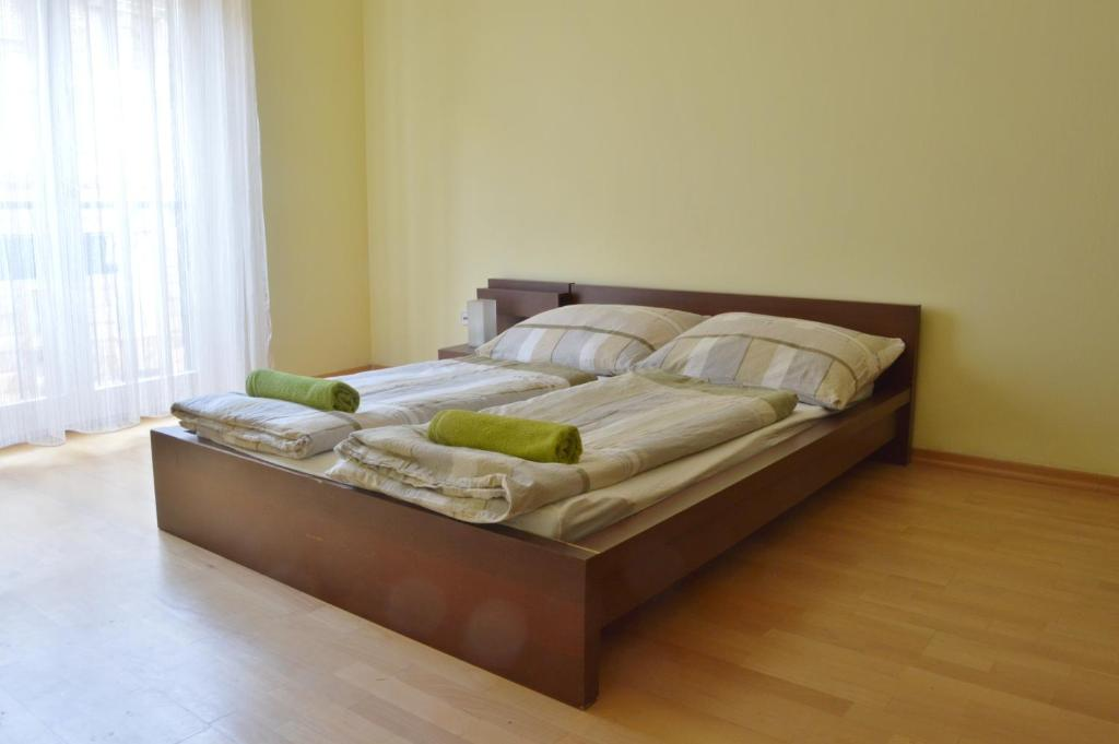 A bed or beds in a room at Rose Garden City Apartment