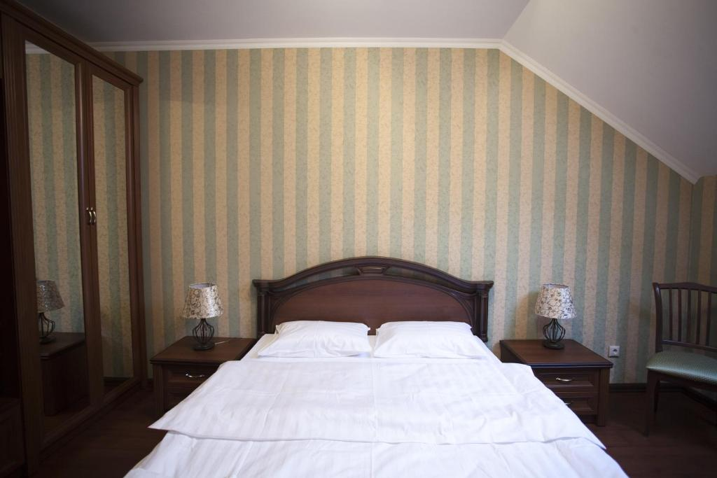 A bed or beds in a room at Guest House 9 Sloboda