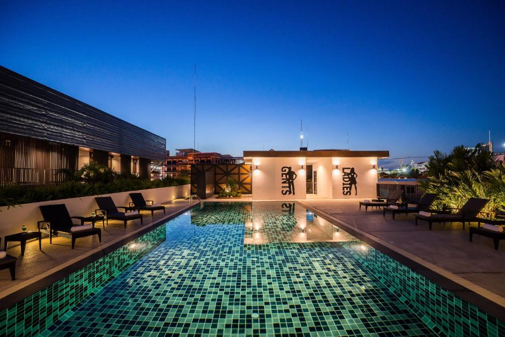 The swimming pool at or near Ivory Villa City