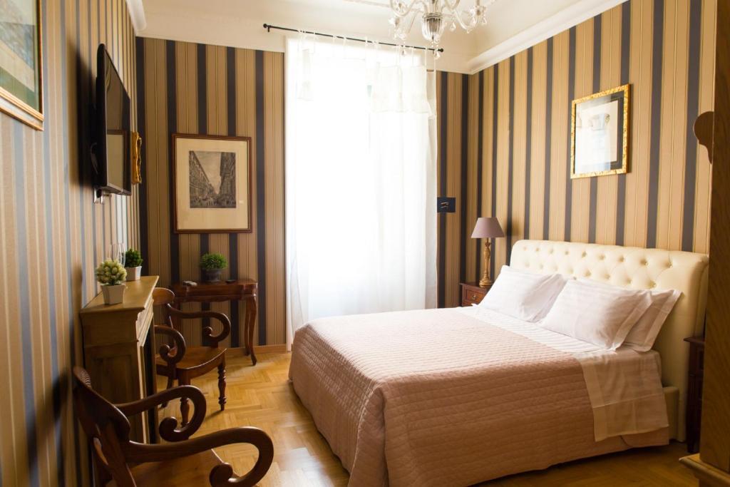 Uma cama ou camas num quarto em Landlord in Trastevere