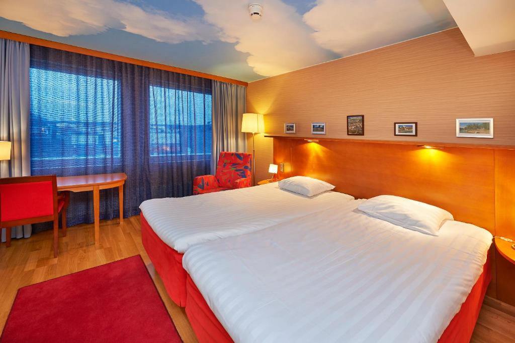 Säng eller sängar i ett rum på Scandic Salo