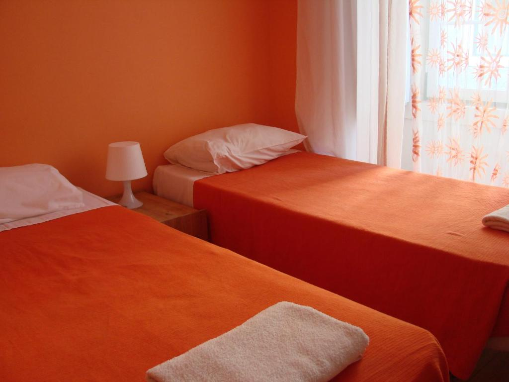 A bed or beds in a room at Lisbon Happy Hostel by Sweethome Hospedagem