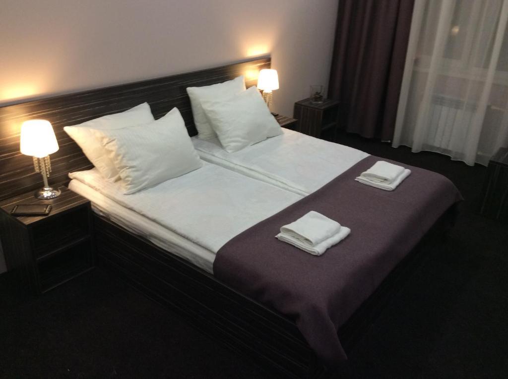 Кровать или кровати в номере Отель Любимый Город