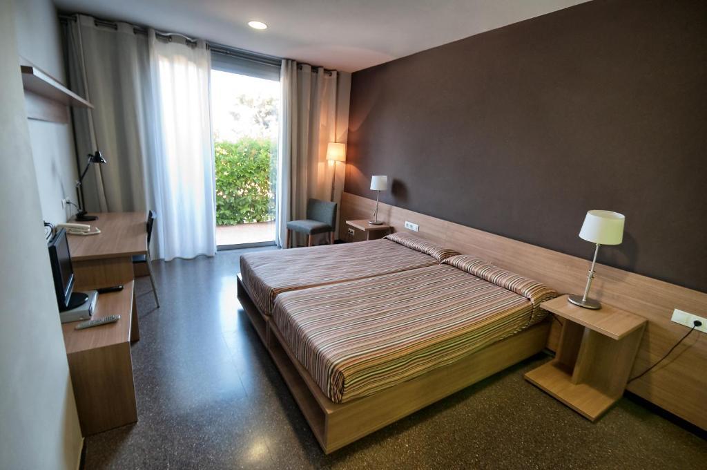 A bed or beds in a room at Àgora BCN. Residencia Universitaria Internacional