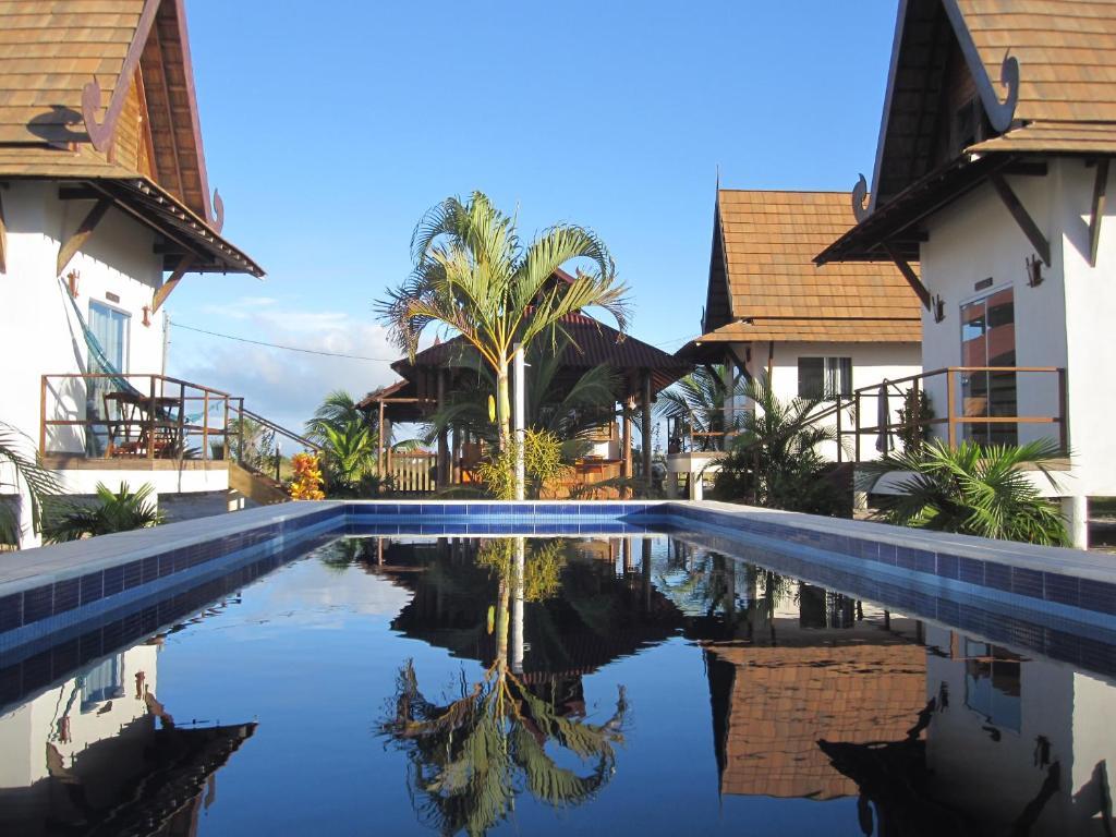The swimming pool at or near Pousada Thai Bungalows