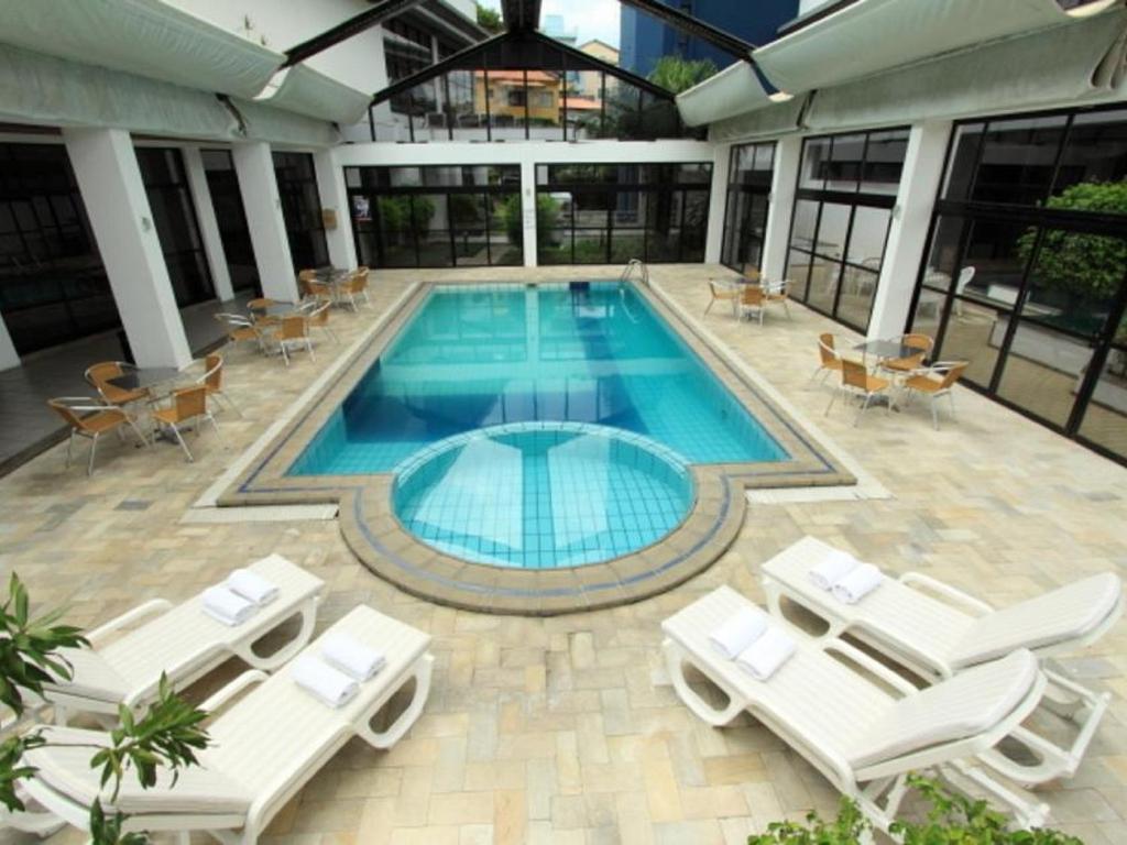 The swimming pool at or near Cambirela Hotel