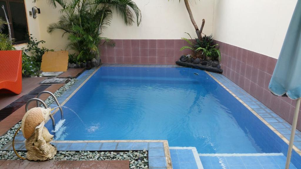 Majoituspaikassa Ayu Taman Sari tai sen lähellä sijaitseva uima-allas