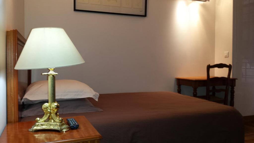 A bed or beds in a room at Résidence Salvy