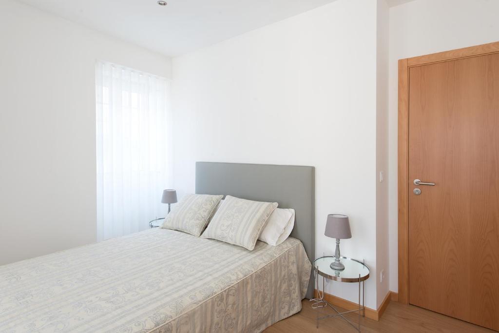 A bed or beds in a room at Terraço da Vila