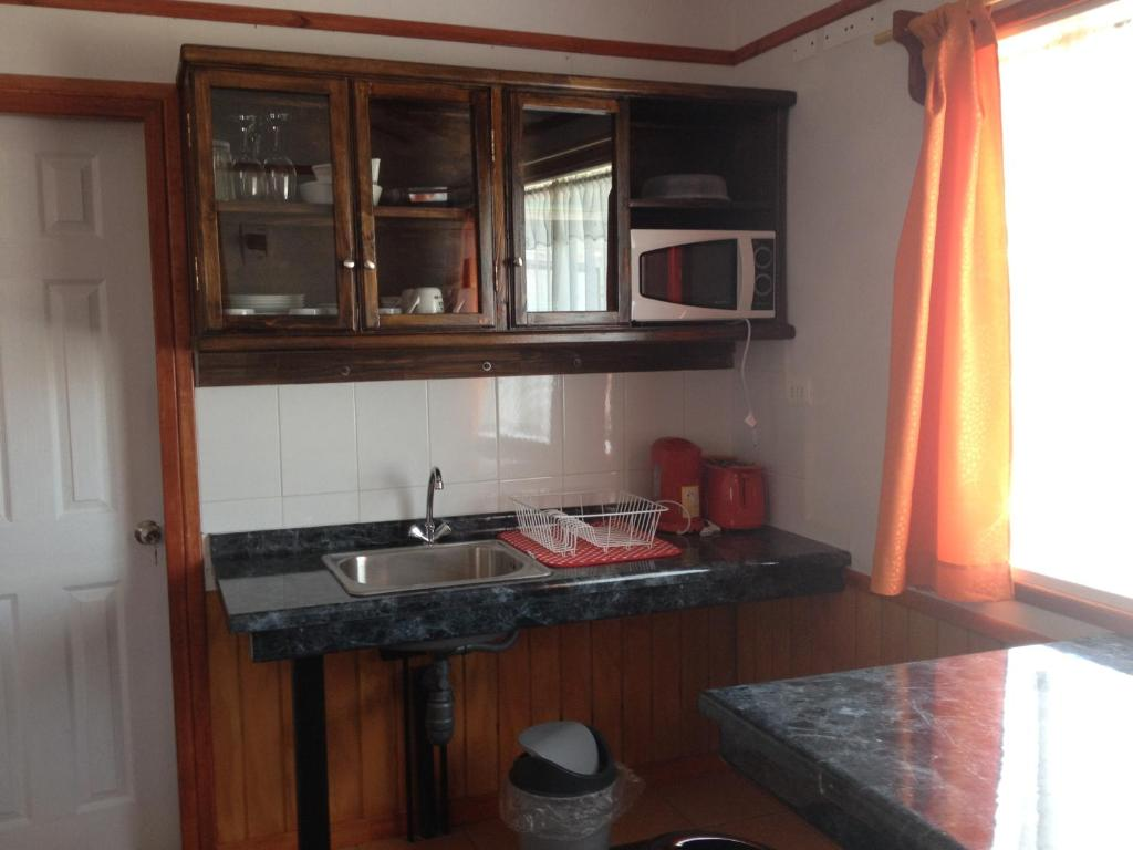 A kitchen or kitchenette at Cabañas El Mirador