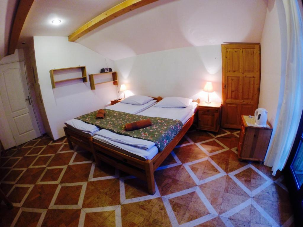 A bed or beds in a room at Willa Alpina