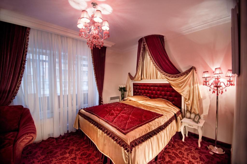 Un ou plusieurs lits dans un hébergement de l'établissement Royal City Hotel