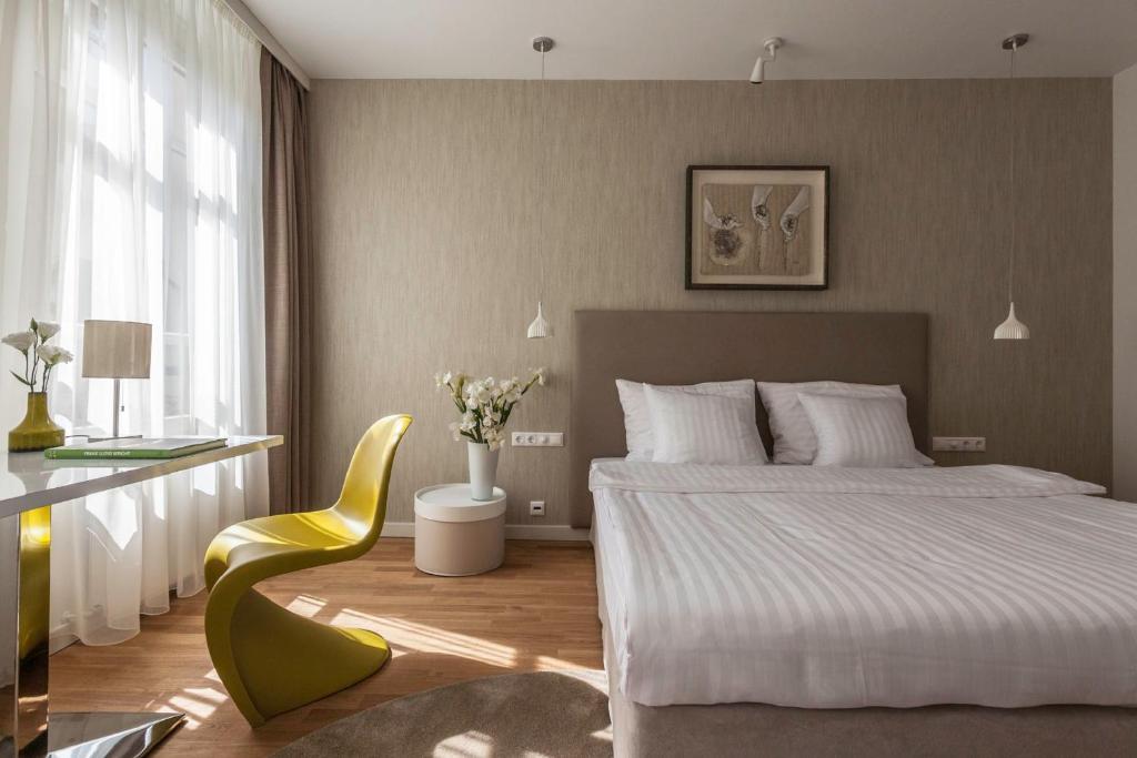 Un ou plusieurs lits dans un hébergement de l'établissement Casati Budapest Hotel Superior