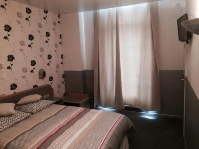 Un ou plusieurs lits dans un hébergement de l'établissement Le Terminus