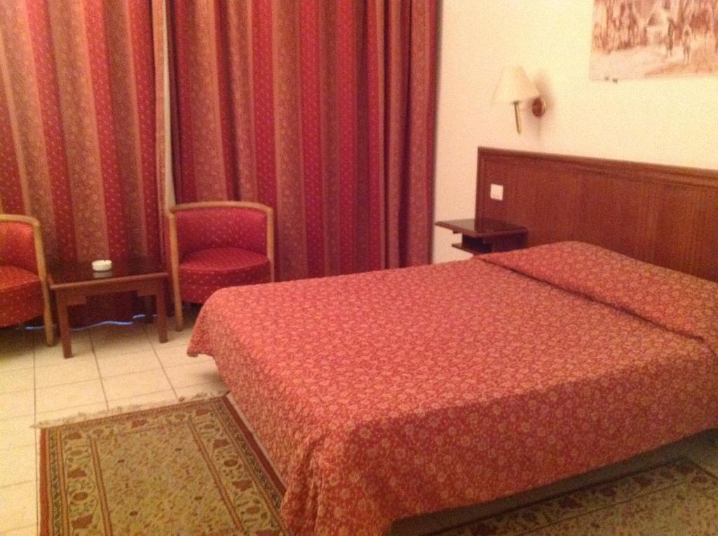 Кровать или кровати в номере El Hana International