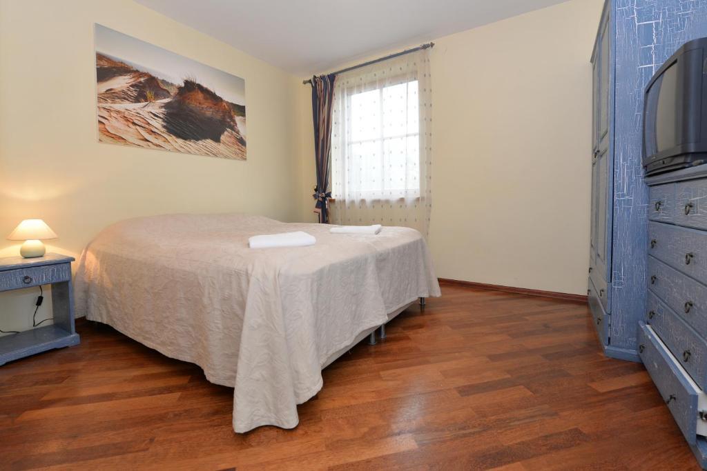 Lova arba lovos apgyvendinimo įstaigoje Nidos Gaiva, svečių namai