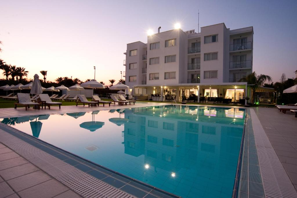 The swimming pool at or near Frixos Suites Hotel Apartments